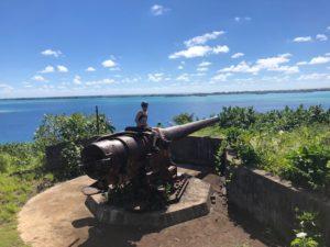 Tahiti tandem tour - Posing on a WWII cannon on Bora Bora