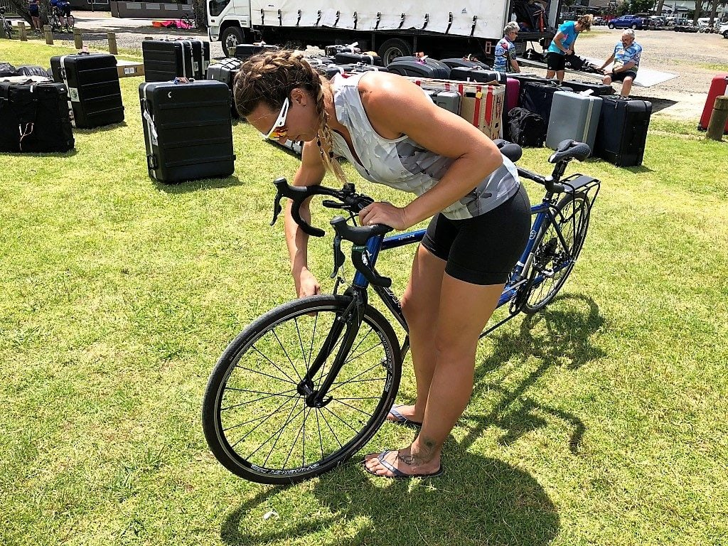 Photo of Joy, Santana Tours bike mechanic, checking brake setup for customers who brought their own bike on cycling vacation