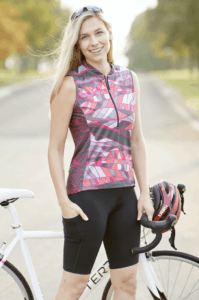 Photo fo cyclist model wearing NEW Terry Bike Bermuda cycling shorts with Breakaway Mesh Sleeveless Jersey in Strata/coral