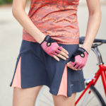 Photo of cyclist model wearing Terry Zipper cycling skirt, showing detail of zippers revealing contrasting inserts