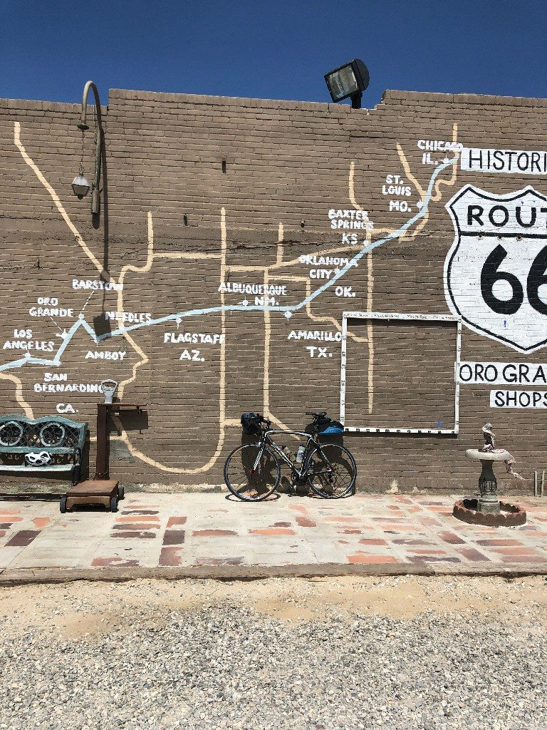 Photo of mural in Oro Grande, California, showing the states and cities along route 66