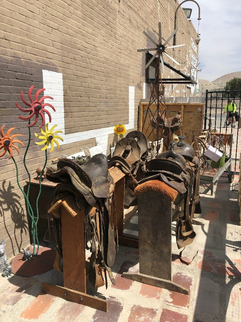 Photo of used saddles for horses outside a store on route 66