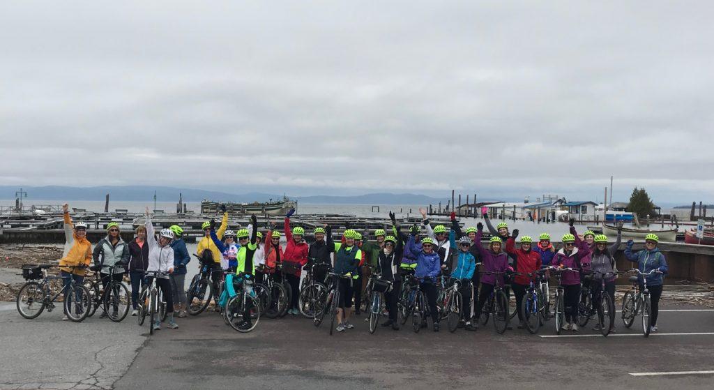 Women's Wellness Revolution Program particiapnts gather on Burlington's waterfront for an urban cycling riding workshop