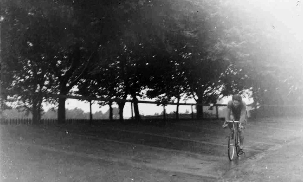 Celebrating cycling dads on father's day – black and white photo of Colin S's dad racing on an outdoor cycling track