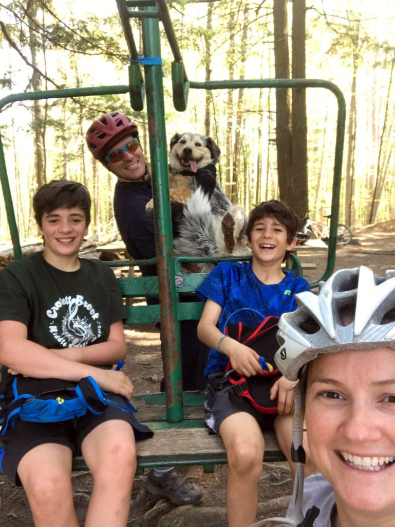 Celebrating cycling dads on father's day – Photo of Andy and family taking a break from mountain biking, on a chairlift at Cady Hill in vermont