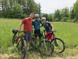 Celebrating cycling dads on father's day – photo of Dave H with family mountain biking at Vermont's Kingdom Trails