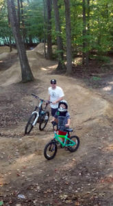 Celebrating cycling dads on Father's Day – photo of Greg on the mountain bike trail with family