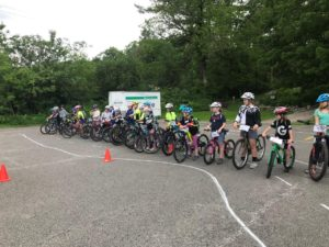 Gritty Girls on mountain bikes  lineing up for a group exercise learning mountain biking skills