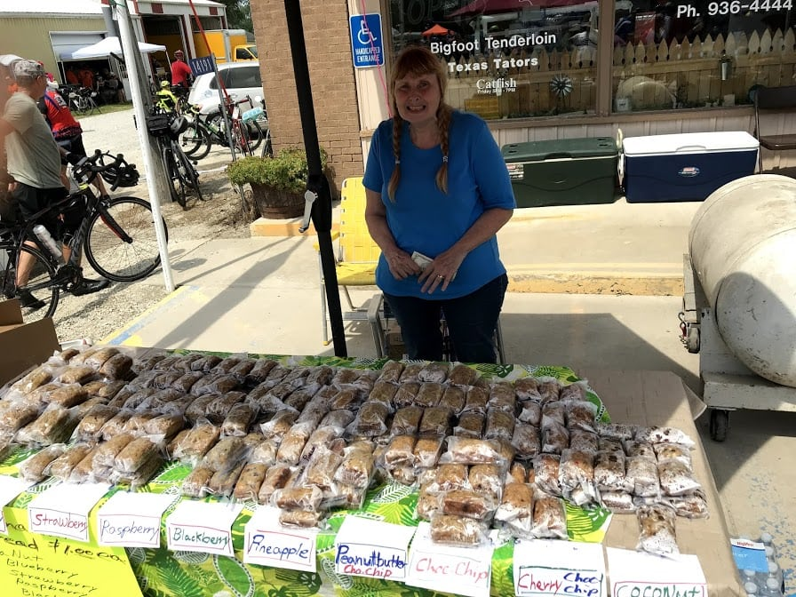 RAGBRAI 2019 - woman in a food stall selling an array of home made bread