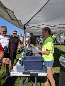 RAGBRAI 2019 - cyclists are served fresh corn on the cob at a food stall