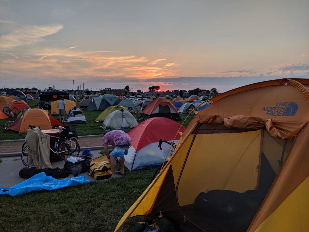 RAGBRAI 2019 - hundreds of tents lit by a lovely sunset, as riders prepare to camp overnight in an Iowa town