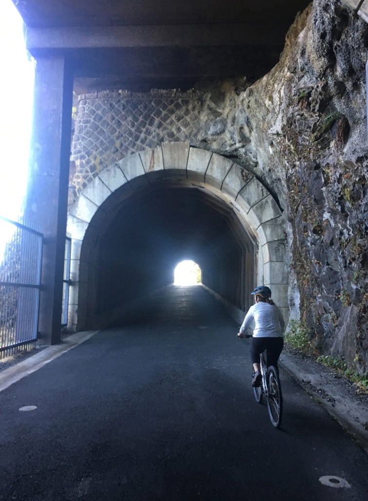 Photo of the author cycling into one of the tunnels on the Historic Columbia River Highway Trail
