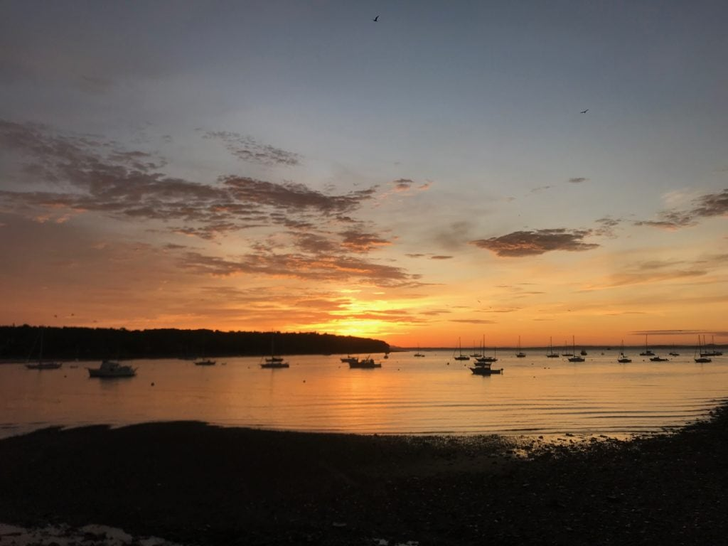 Sunrise view of small boats moored in a Maine bay