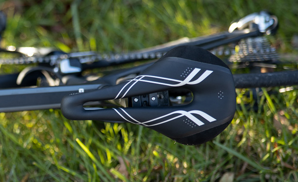 Close up view of the top of the Terry Corta bike saddle on a bicycle laid on its side in the grass